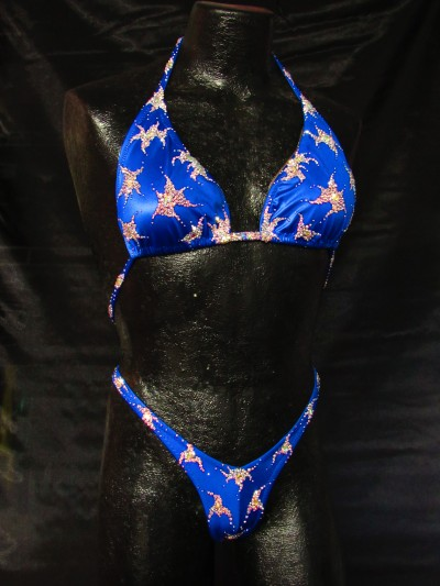 Mannequin wearing a blue bikini with crystals