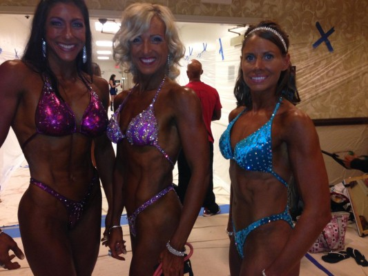 Three women in Merry Christine Bodywear posing suits.