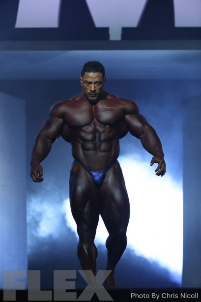 Roelly Winklaar at the 2018 Olympia in a Merry Christine Bodywear men's competition suit