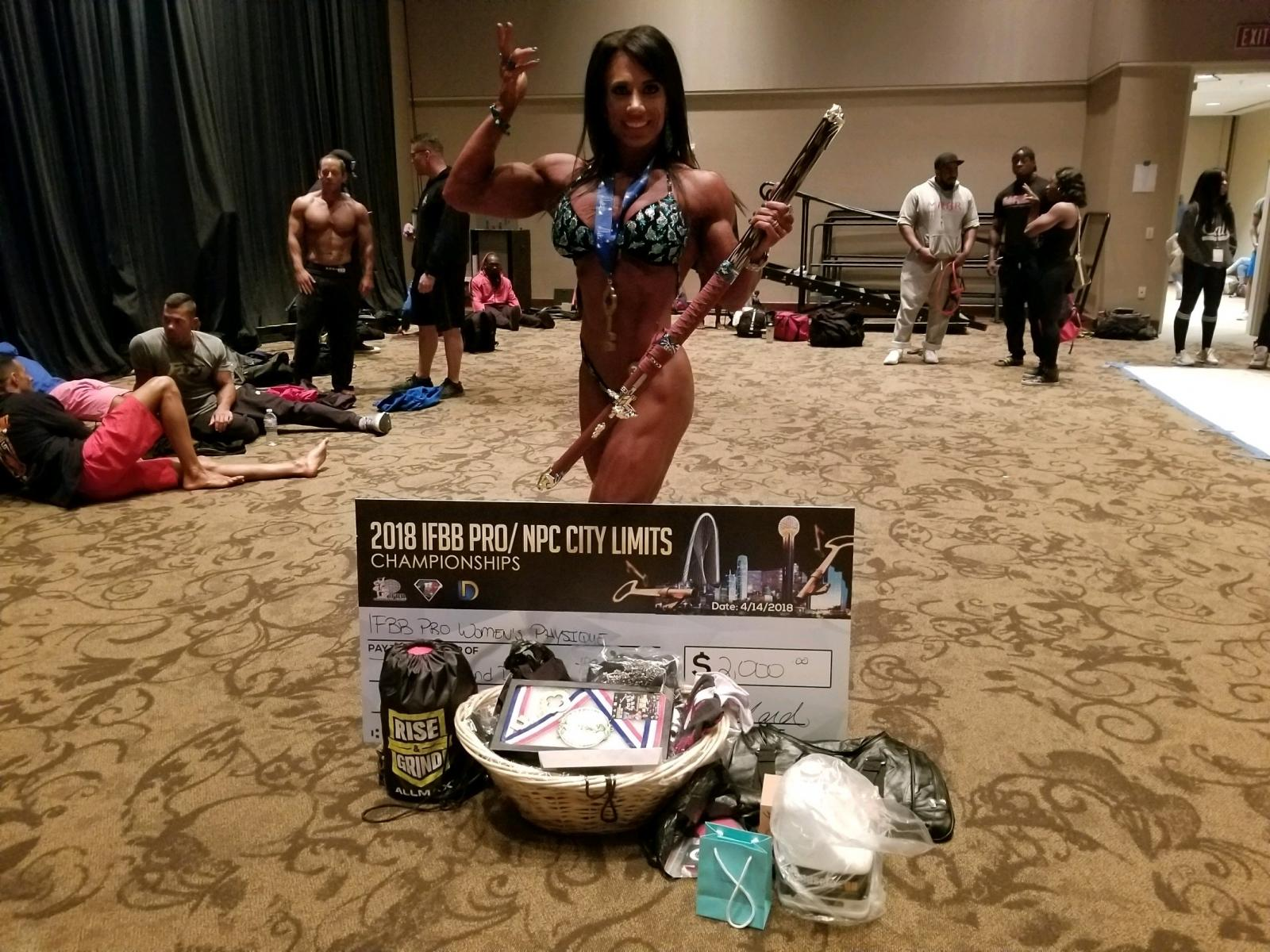 Melissa Pearo at the 2018 IFBB PRO/NPC City Limits Merry Christine Bodywear Women's Physique competition suit