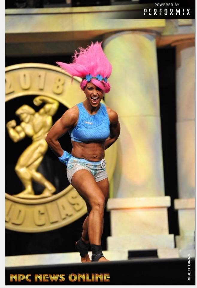 NPC Fitness competitor Kristy Avery wears a Merry Christine Bodywear designed fitness competition suit.