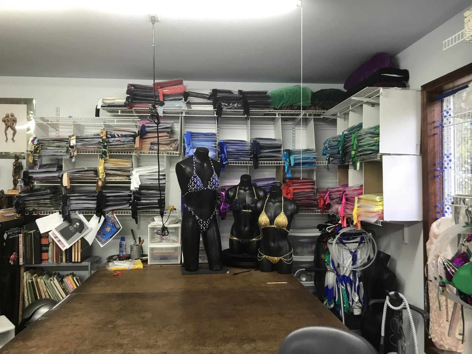 Fabrics and cutting table in Merry Christine Bodywear shop