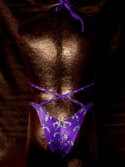 Back of mannequin wearing a purple bikini with crystals
