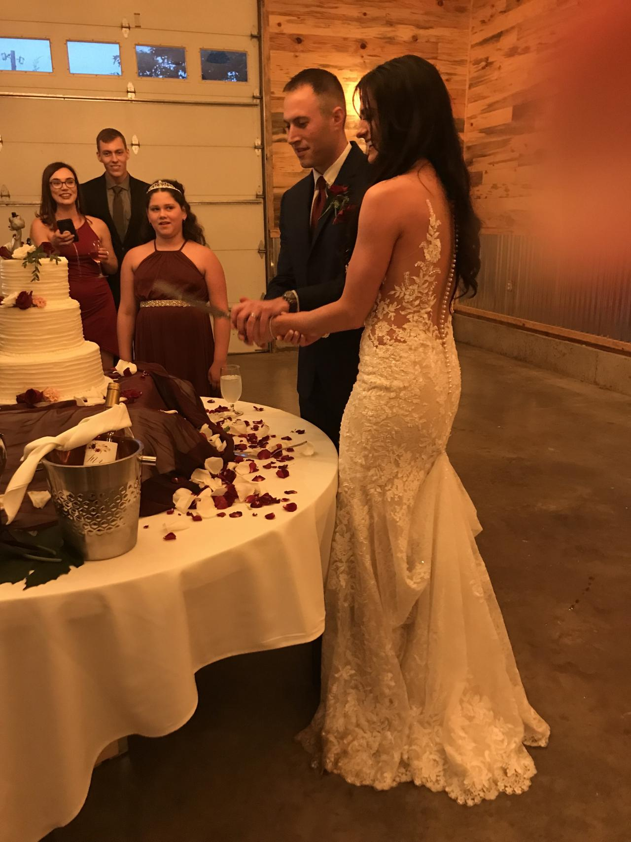 Christina and Jeremy Ettedgui cutting the wedding cake.